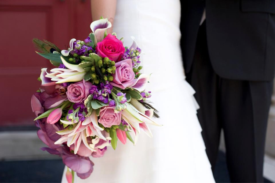cascading modern bouquet in bright colors pink orchids
